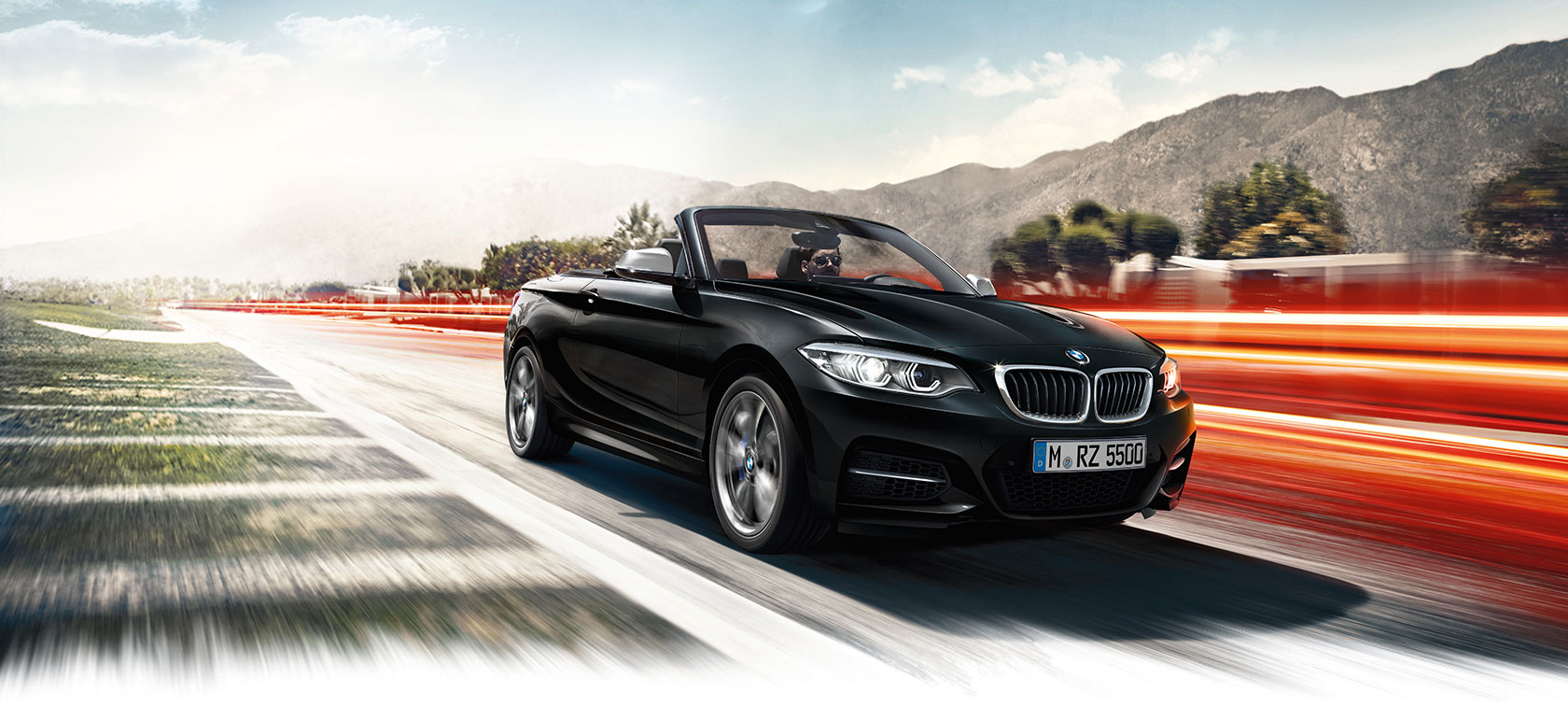 New BMW 2-Series Convertible black car: driving on hills