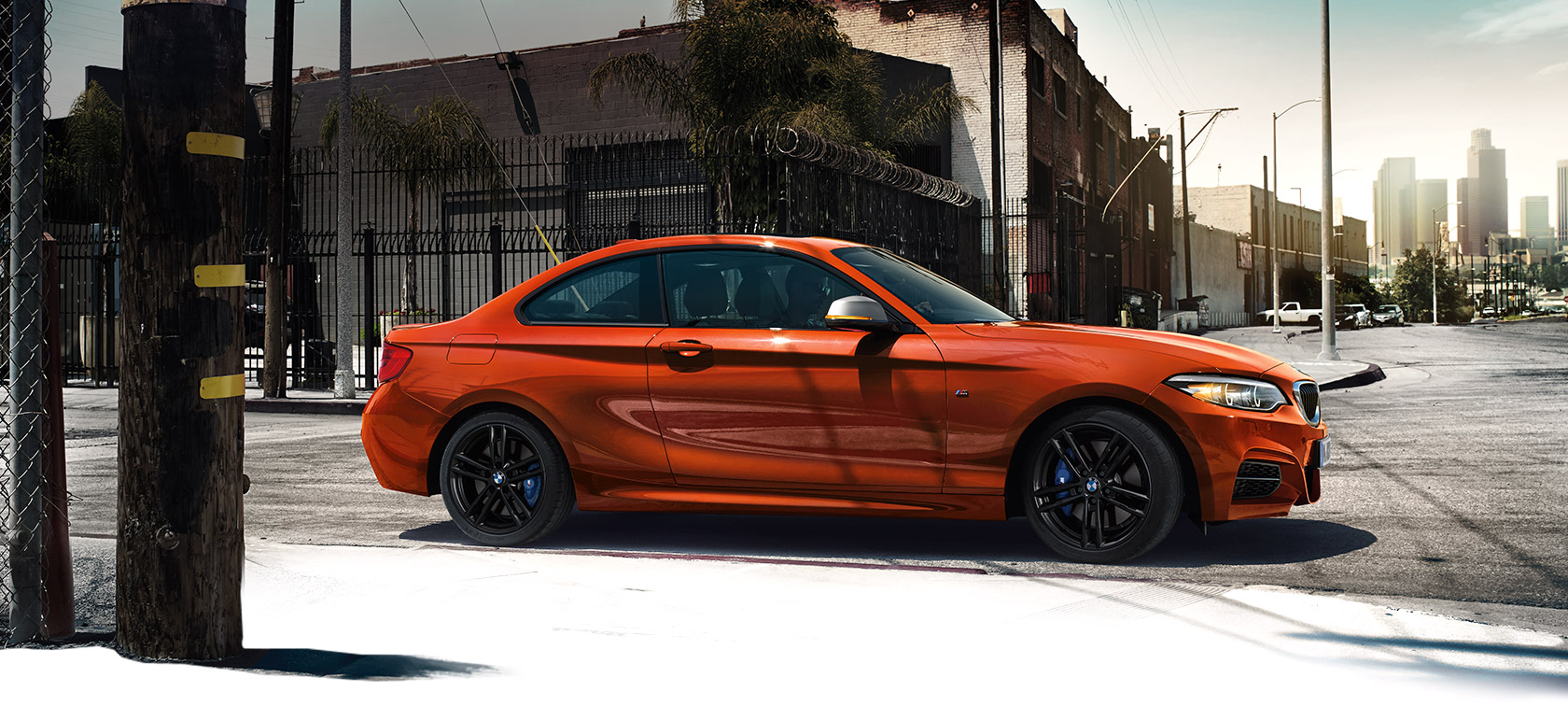 BMW 2-Series Coupe metallic orange side view