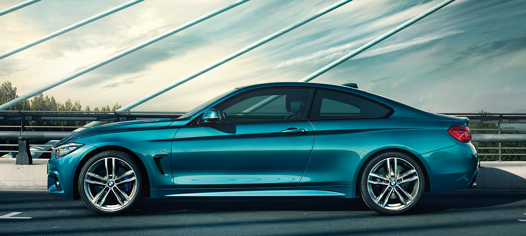 BMW 4-Series Coupe blue side view: on bridge