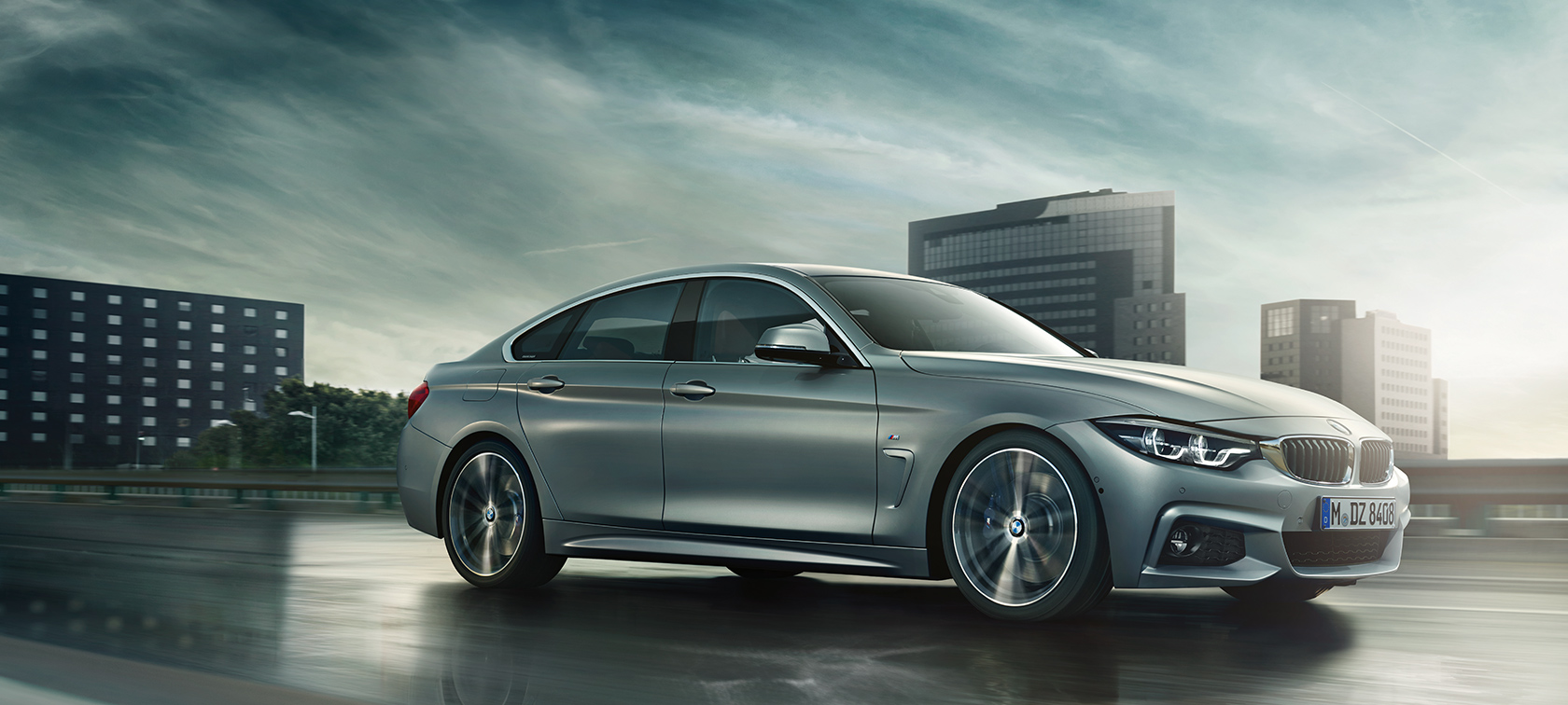 BMW 4-Series Gran Coupe metallic car: streets after rain