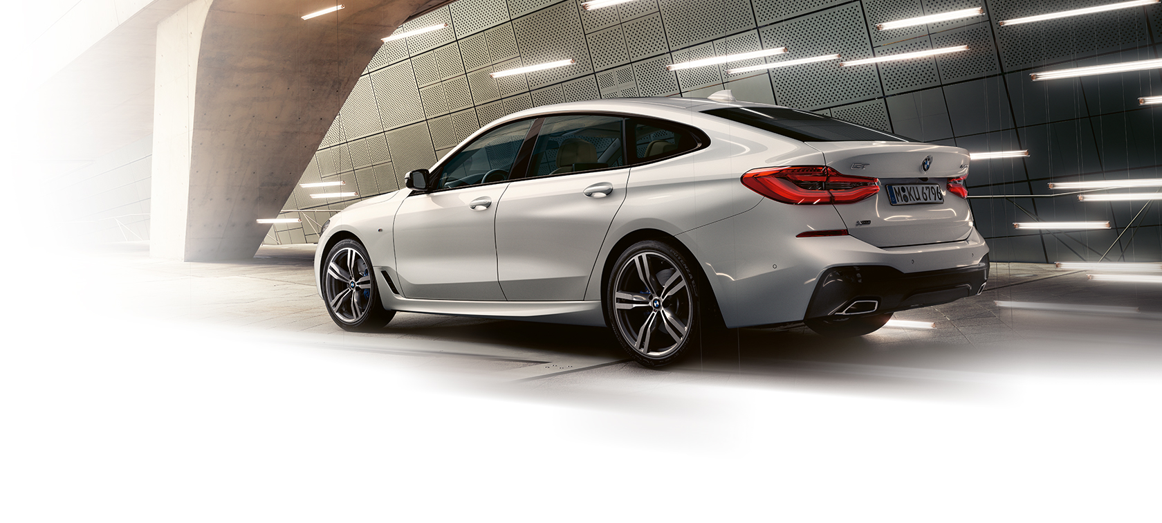 BMW 6-Series Gran Turismo grey rear view: lights tunnel