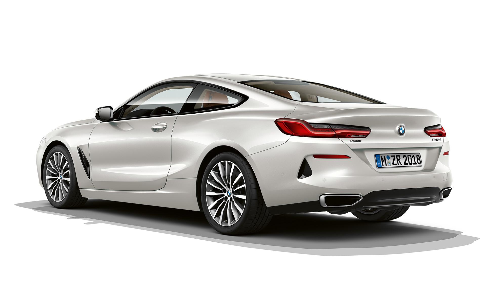 Still shot of the BMW 8 Series Coupé in Bluestone metallic against a white background.