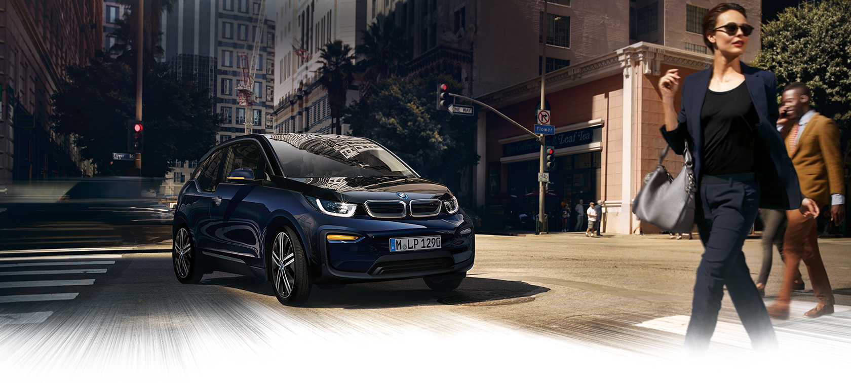 BMW i-Series i3 dark blue city car on crossway