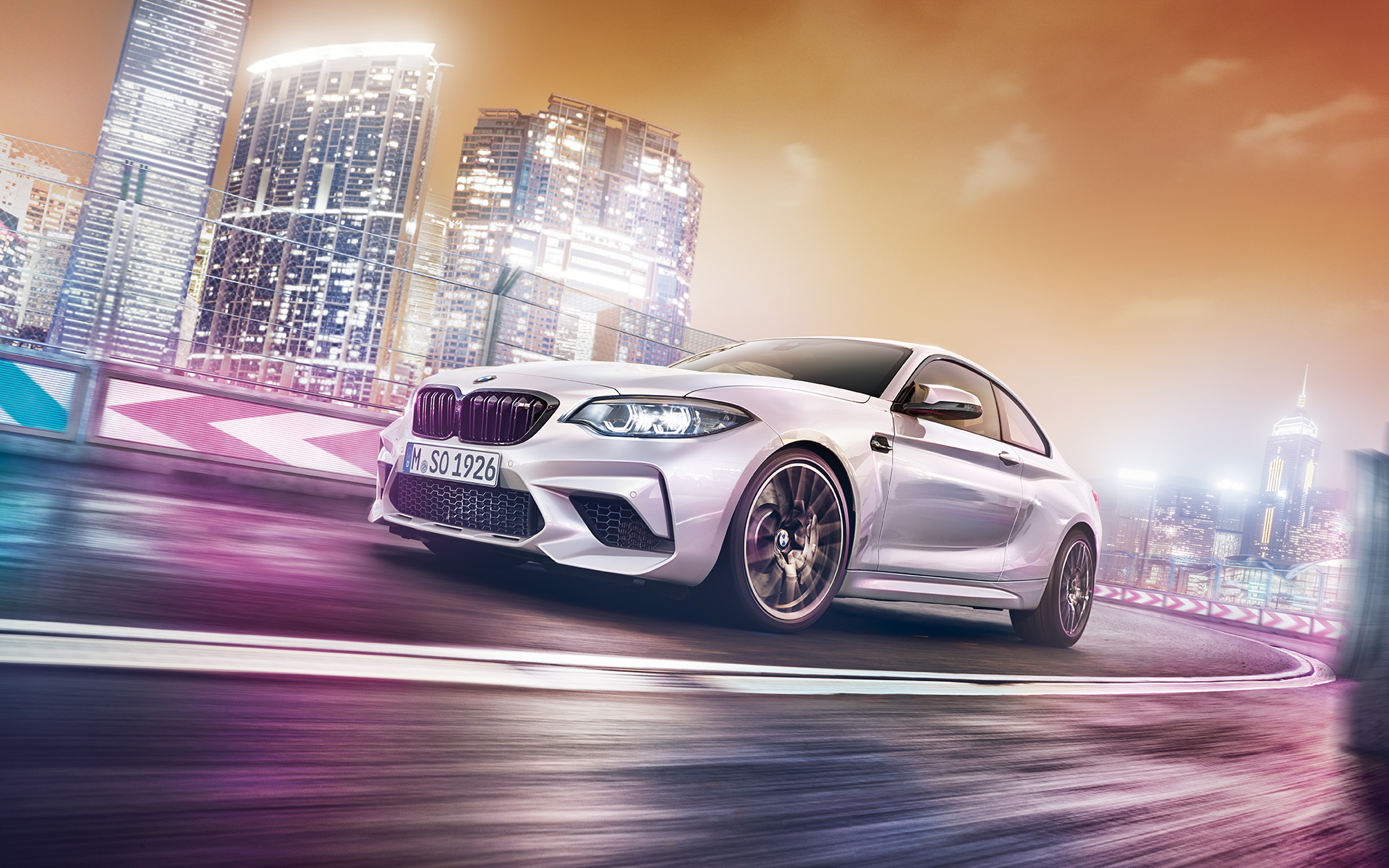 BMW M-Series M2 Coupe metallic car: city highway lights