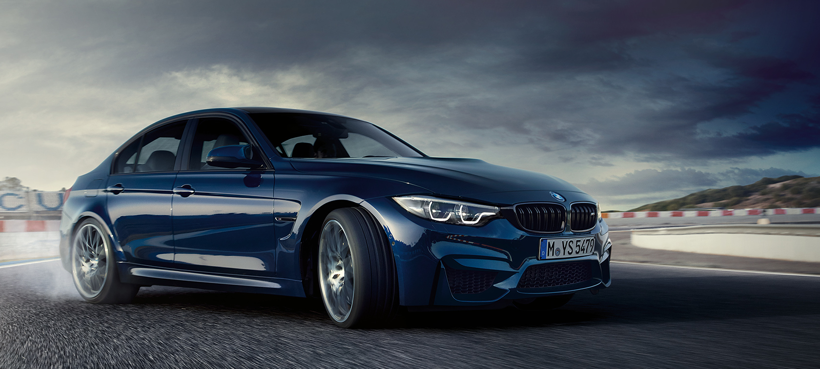 BMW M-Series M3 Sedan in dark blue: speeding car frontside view