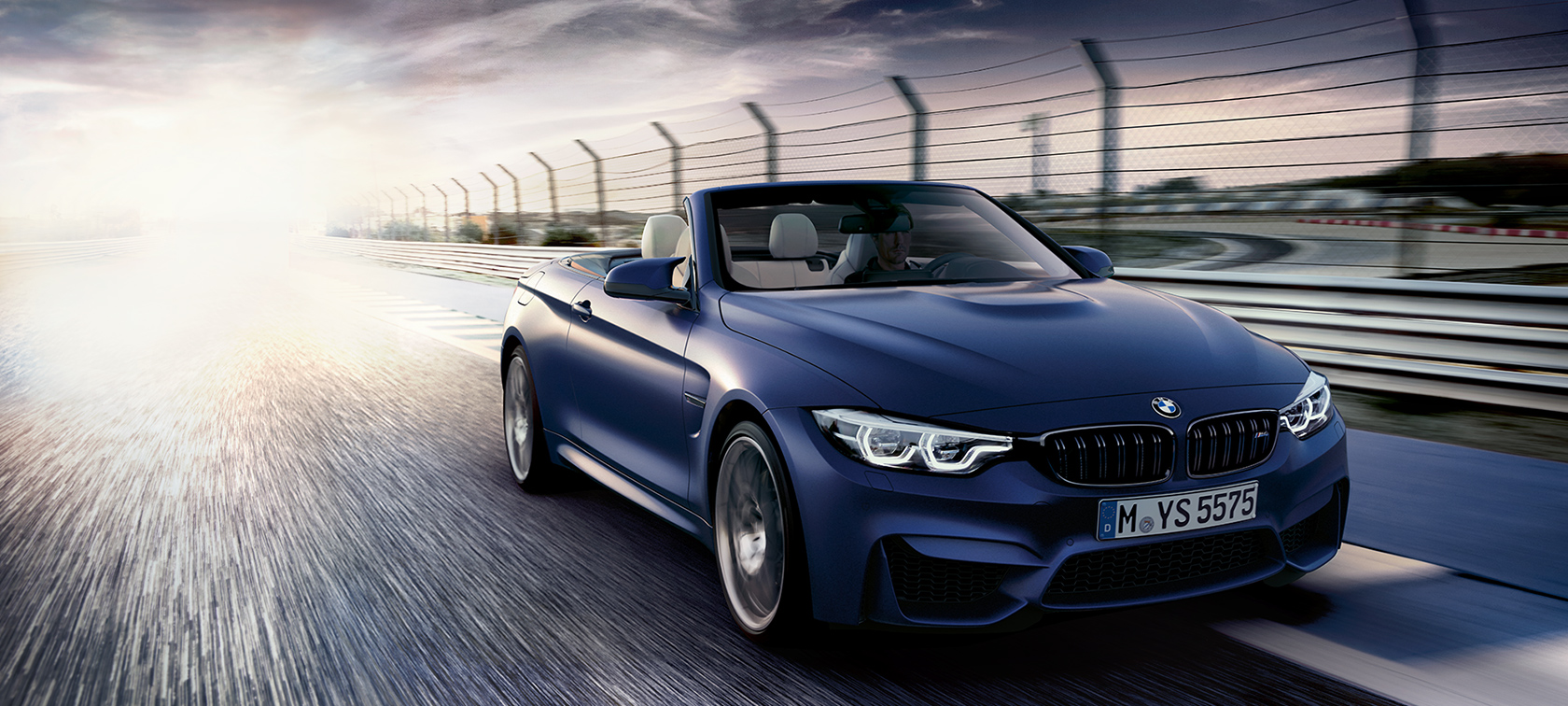 BMW M-Series M4 Convertible dark blue: fast moving car on highway