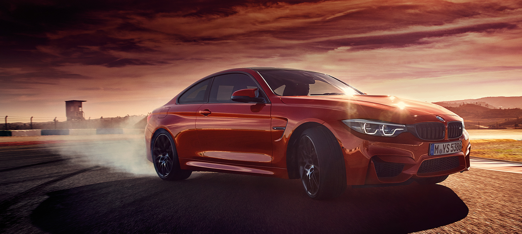 BMW M-Series M4 Coupe red in a dusty road