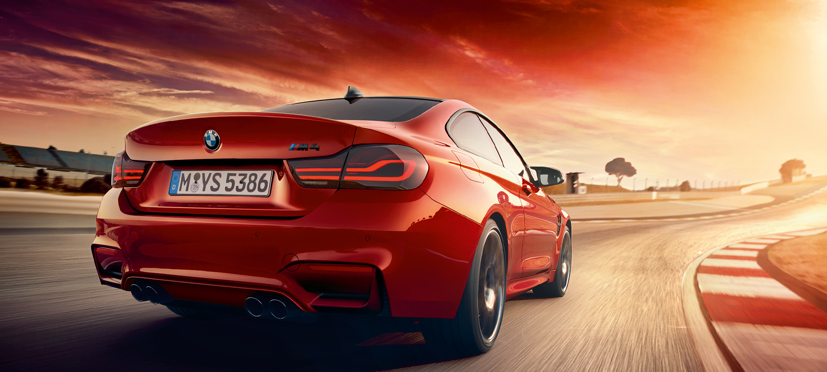 BMW M-Series M4 Coupe red: sunset road drive