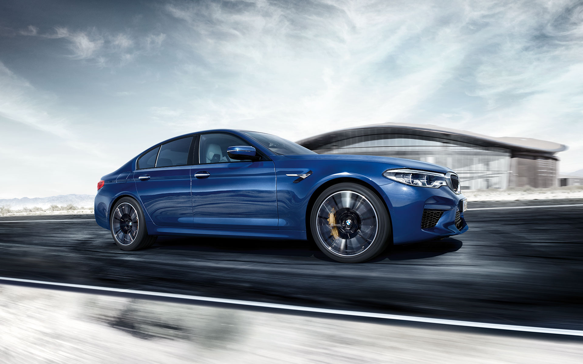 BMW M-Series M5 Sedan in blue side view control on the snow