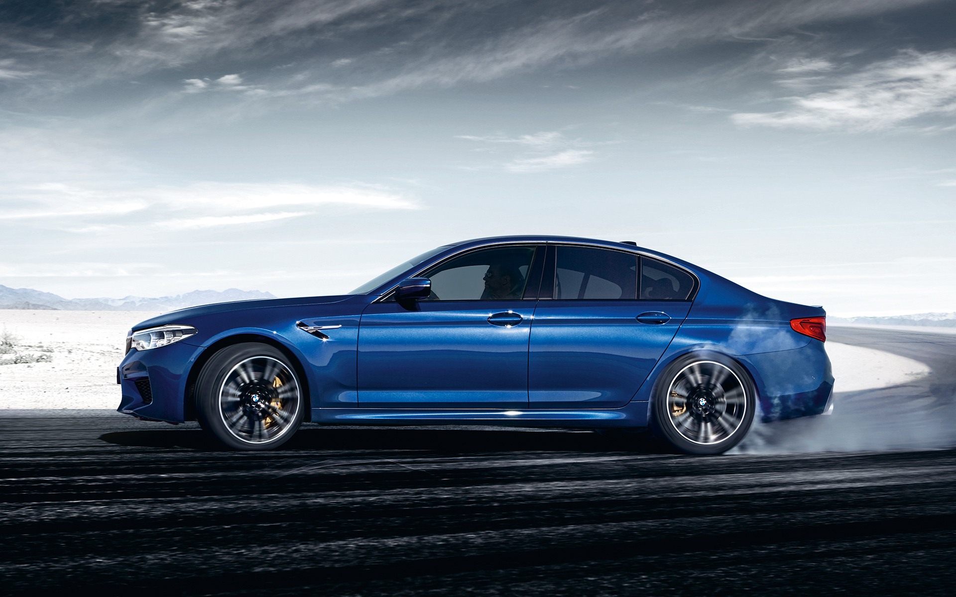 BMW M-Series M5 Sedan in blue side view: snow performance