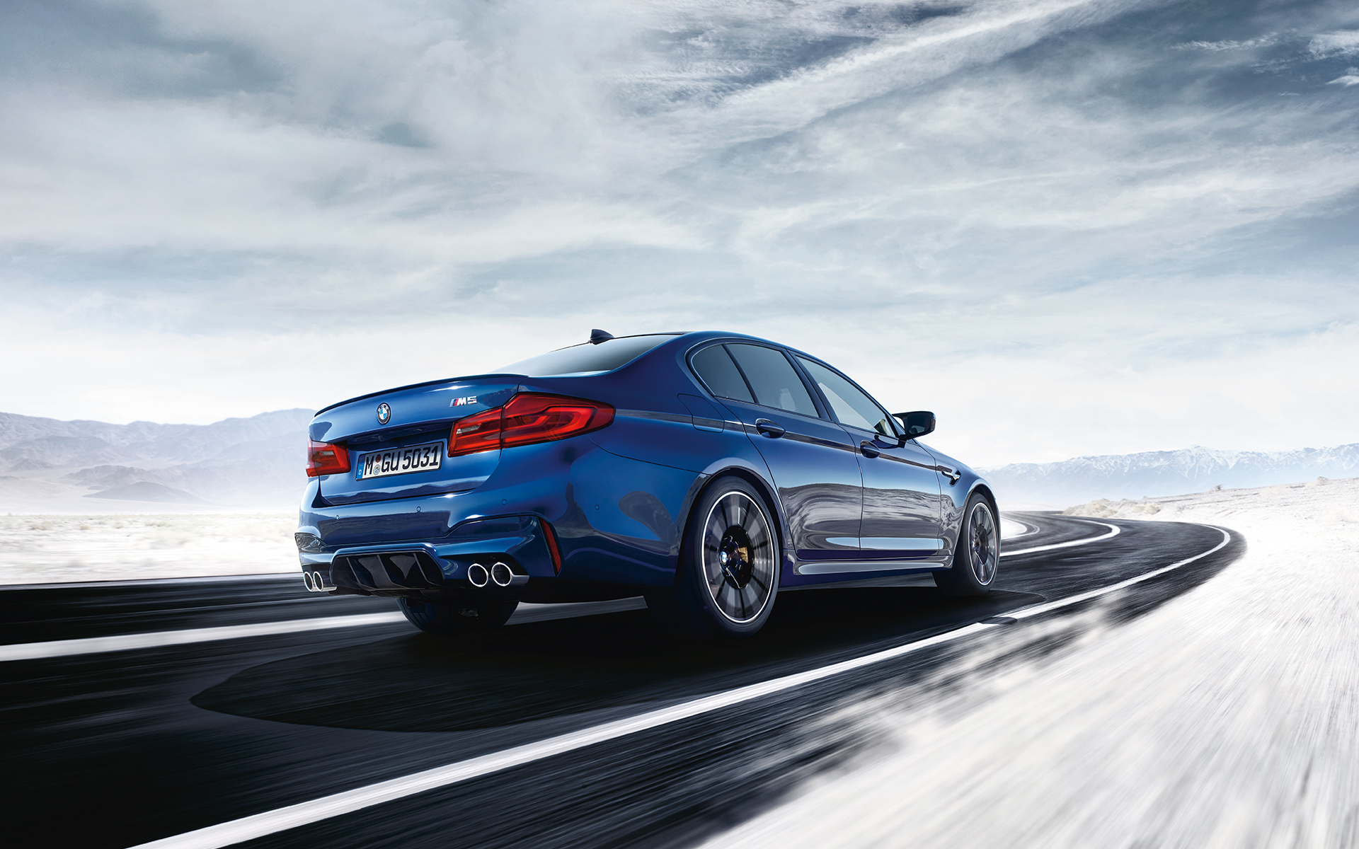 BMW M-Series M5 Sedan blue car: slippery surface performance
