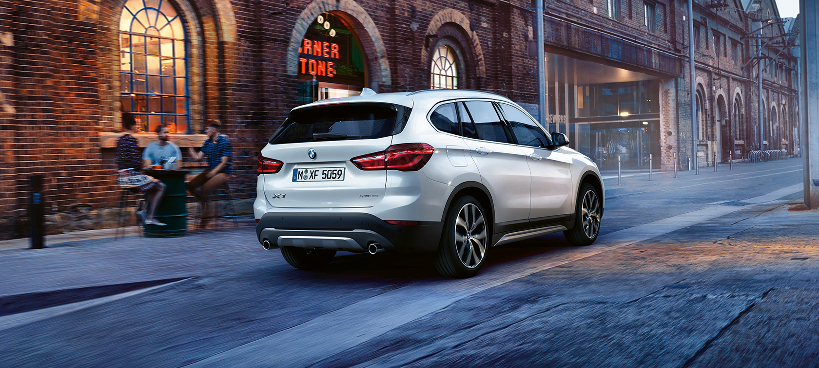BMW X-Series X1 in metallic: rear view close to bar